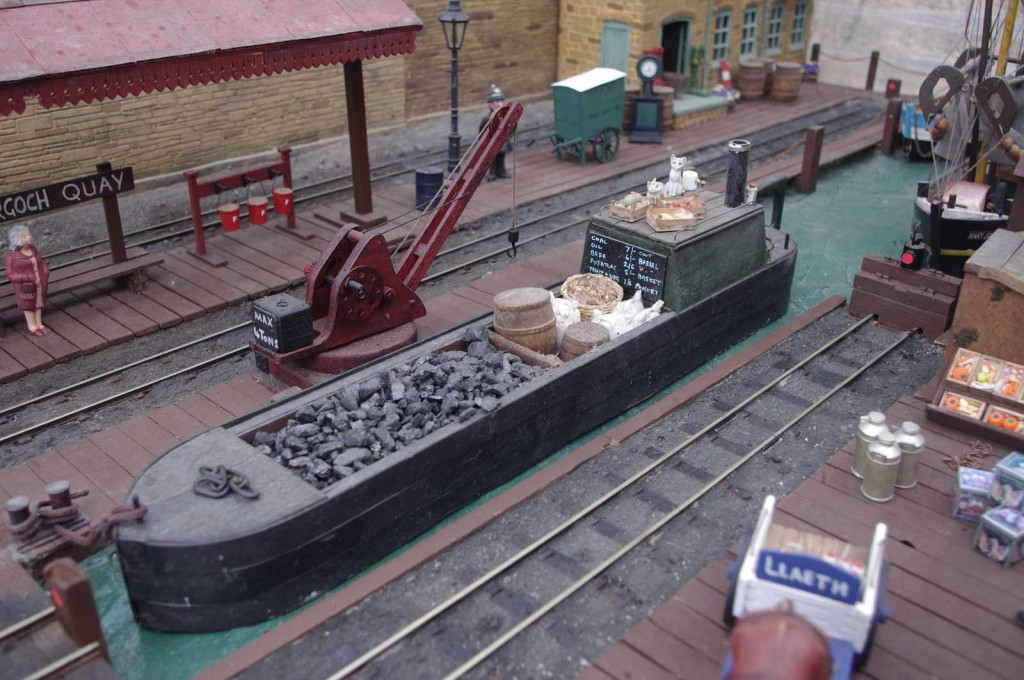 The first, scratchbuilt barge, carrying general goods, seen at the old dock.